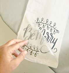 DIY Hand towel for Christmas Flour Sack Christmas Towel - Be Merry Easy to make and use yourself for Christmas or include in a hostess gift. Cricut heat transfer vinyl project from our vinyl contributor, Jenni. Be Merry.I'm thinking great Christmas Hand Towels, Christmas Kitchen Towels, Kitchen Hand Towels, Christmas Tea, Xmas, Christmas Crafts, Dish Towel Crafts, Dish Towels, Diy Tea Towels
