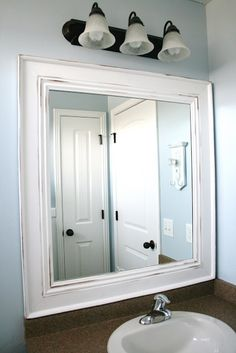 """Tutorial for framing out the builder-grade mirror in the bathroom(s). Could """"easily"""" use a miter board/saw since I don't have access to power tools. And I imagine the trim possiblities are vast at Lowes and Home Depot. Must do. -tkz"""