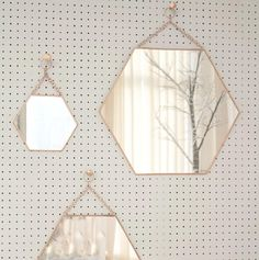 An antique style mirror. This decorative hanging hexangonal shaped copper mirror has a really lovely antique feel to it. With a metal chain to hang the mirror, the unique design will look just as good in a bathroom, bedroom or hallway either as a single mirror or set of three. This mirror can be used for practical purposes or can be used for decorative purposes- it can help create the illusion of space. Small, medium or large sizes available.