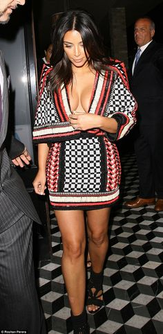 Busting out: Kim Kardashian came close to suffering a wardrobe malfunction as she stepped out at Craig's in West Hollywood after the MTV Video Music Awards on Sunday night