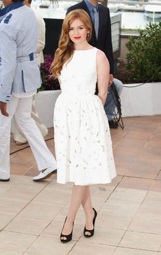 Isla Fisher is fresh as ever in a white Dolce & Gabbana dress. Cannes 2013.