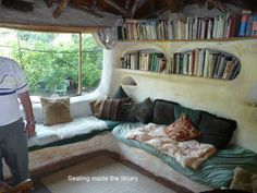 Inside a cob house. Inset bokkshelves and window seating