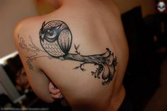 Love the round owl with big eyes as a tattoo