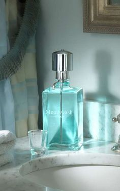 Keep mouthwash handy and counter spaces clear of unsightly bottles with this handsome glass decanter.