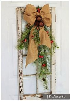 cedar pine cone and rustic bell swag, christmas decorations, repurposing upcycling, seasonal holiday d cor, I purchased the rustic bells from the craft store and wired them onto the swag Christmas Porch, Noel Christmas, Outdoor Christmas Decorations, Winter Christmas, Burlap Christmas, Decorating Porch For Christmas, Christmas Wreaths For Windows, Cabin Christmas Decor, Rustic Christmas Crafts