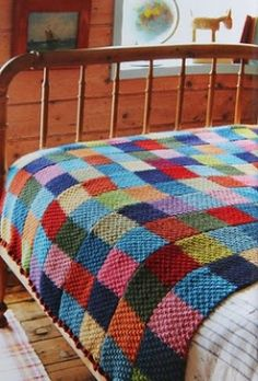 """Great idea: """"For this blanket, Jane used double moss stitch and knit five """"scarves"""" that were then sewn into one big blanket."""" Find a scarf pattern (or two) and then make scarves in to a blanket. More interesting than knitting a whole blanket! Crochet Quilt, Knit Or Crochet, Crochet Scarves, Blanket Crochet, Patchwork Blanket, Knit Squares Blanket, Easy Knit Blanket, Patchwork Ideas, Square Blanket"""