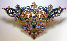 An antique Russian large gilded silver and shaded cloisonne enamel applique in 17th century style, Moscow, circa 1900, unmarked, elaborately decorated with two stylized birds and floral designs, set with two cabochon garnets and a cabochon amethyst. http://www.romanovrussia.com/FRapplique.html