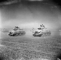 Sherman tanks of the Eighth Army move across the desert as the Axis forces begin to retreat from El Alamein.