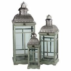 """Set of three wood and glass lanterns with metal tops and a distressed green finish.  Product: Small, medium and large lanternConstruction Material: Metal, wood and glassColor: Light green and silverAccommodates: (1) Candle each - not includedDimensions: 33.46"""" H x 12.59"""" W x 12.59"""" D (large)"""