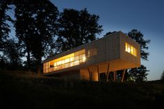 Built by Juri Troy Architects in Hutten, Austria The house under the oaks is a low budget passive house concept developed for an Austrian family. With a minimum footp...