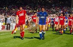 Everton 1 Liverpool 1 in Aug 1986 at Wembley. Captains, Alan Hansen and Kevin Ratcliffe, with the shared Charity Shield. Liverpool Football Club, Liverpool Fc, Hillsborough Disaster, Gerrard Liverpool, Merseyside Derby, Community Shield, Football Images, Everton Fc, Fa Cup