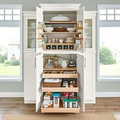 Love this - top contains dishes, middle for small appliances, bottom has slide outs for pantry staples etc