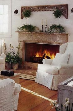 2013 Christmas Fireplace decor, fresh green garland, white candles, Fireplace Decor Ideas for Christmas #Christmas #Fireplace #decor www.lov...