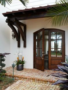 The Chic Technique: Florida beach house exterior - we just can't get over those wooden front doors! The whole house is incredible. House Design, House Front, Coastal Interiors, House Exterior, Exterior Design, Beach House Exterior, Florida Beach House, Spanish House, Spanish Style Homes