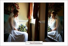 A Bride taking a moment to herself in our Bridal Suite.