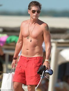 Looking good! Rob Lowe displayed his toned figure as he soaked up the sun in Saint Tropez,...