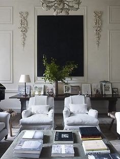 Even the books on the table are kind of symmetrical. The decor on the walls and the arm chairs are symmetrical. They make the room seem very formal. Living Room Modern, Home Living Room, Living Room Decor, Living Spaces, Living Room Inspiration, Interior Inspiration, Grey Interior Design, Elegant Homes, New Wall