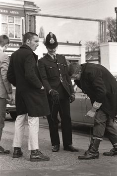 Boots were one of the most important parts of the skinhead uniform before being classified as weapons (as a police officer is pictured asking for them to be handed over) and the Doc Martens style moved in Skinhead Men, Skinhead Boots, Skinhead Fashion, Skinhead Style, Doc Martens Style, Uk History, Fashion History, Hippie Culture, New Romantics