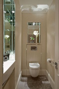 Guest WC with sink recessed into the wall © Hill House Interiors