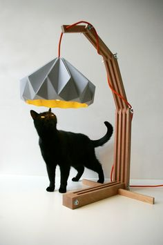 origami paper lampshades (by Studio Snowpuppe) + killer lamp + inquisitive kitty = MADE FOR ME Origami Lampshade, Paper Lampshade, Lampshades, Origami Table, Wooden Lampshade, Table Design, Lamp Design, Wood Lamps, Paper Art