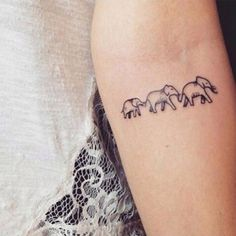 This tiny elephant tattoo reminds you of the powerful, loyal woman with deep family values that you are. This tiny elephant tattoo reminds you of the powerful, loyal woman with deep family values that you are. Elephant Family Tattoo, Elephant Tattoo Design, Elephant Tattoos, Simple Elephant Tattoo, Elephant Tattoo Meaning, Mini Tattoos, Trendy Tattoos, New Tattoos, Tattoos For Women