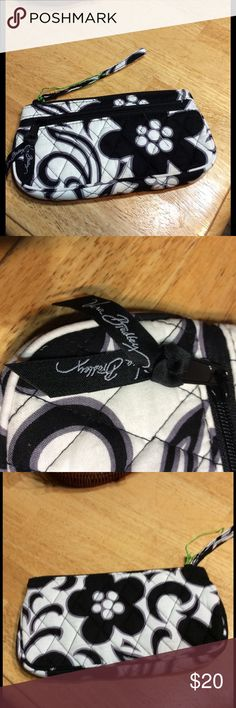 Vera Bradley night and day wristlet new Vera Bradley nigh and day. Black and white zippered wristlet. Outside zippered pocket. Measures 9 inches long and 5.5 inches wide. New. Lost the tag but still has the string it was attached to on the bag. Smoke free home. Vera Bradley Bags Cosmetic Bags & Cases