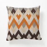 Kinda Charlie Brownish, which is probably why I like it!  Found it at Wayfair - Global Bazaar Diamond Echo Pillow in Orange