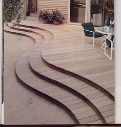 Wooden decks can be an immediate extension of a house or a remote space overlooking a particularly spectacular vista and be designed in many shapes and sizes.  This one bows where it needs to, where a table and chairs need more room than circulation.