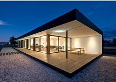Modscape, modernist style Floor lines up with deck, ceiling and eaves line up, matched interior and exterior lines Full height glass and doorways