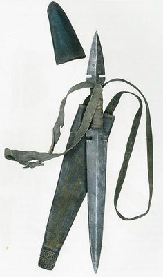 Fighting knife from the North West Pacific Coast in the Americas. Owned by Louis Colville Gray Clarke. Given to the Museum in 1921. This unusual double-ended steel fighting knife was probably made by the Tlingit, an indigenous people of the costal regions of Alaska and Canada in north-western North America. It dates to around 1800. The mounts are copper, the grip is bound in hair and the attached sheath is made of pieces of animal skin.