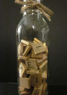 Have a jar of scrabble tiles on some of the guest tables, along with a disposable camera.  Encourage the guests to spell messages out to the bride and groom, and snap a photo!
