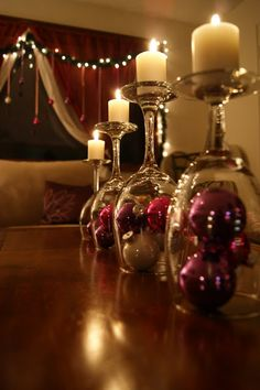 Simple DIY holiday decor using wine glasses! :: Turn wine glass upside down & use it as a glass lid for a small arrangement of Christmas decorations (ornaments, ribbon, whatever you like). Then place mini candles on top! Noel Christmas, Winter Christmas, All Things Christmas, Christmas Ornaments, Christmas Candles, Christmas Centerpieces, Christmas Balls, Table Centerpieces, Centerpiece Ideas