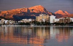 The Tramuntana mountains reflected in Pollença Bay, Mallorca.