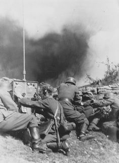 German radiomen come under fire somewhere on the Eastern Front, summer 1941. Note the substantial whip antenna of the main radio unit. The artillery shell explosion is too close for comfort -- and the men around the radioman, who remains cool, shrink instinctively.