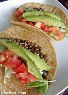 Tacos de lentejas. Beans, sauteed with onion, tomato and avocado. Seasoned with paprika, cumin, oregano, salt and pepper.
