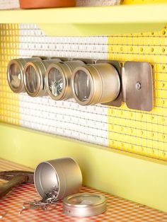 Clearly Organized. Magnetic spice containers for loose screws ~ you can see (and easily find them) would be great for many small bits and pieces!!