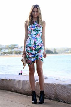 STYLIST Tip: Wear a floral summer dress with your favorites winter booties to transition between season.