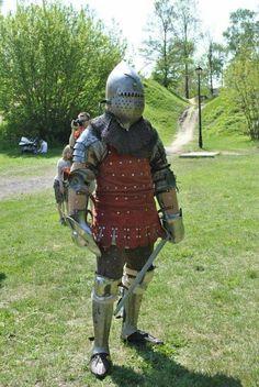 Brigandine with bascinet wielding sword and buckler