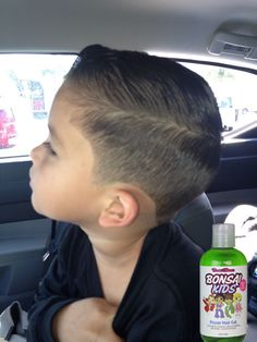Great hair cut... and a little gel.  www.bonsaikids.com/gel