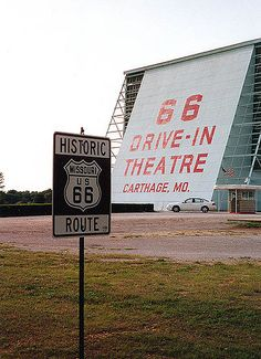 Historic Route 66 sign, situated in front of the Route 66 Drive-In Theatre in Carthage, Missouri. Photo taken Sunday 5 May 2002.
