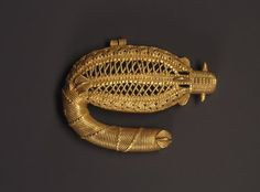 Unidentified Ebrié artist. Pendant in the Form of a Sawfish, 19th century. Gold, 2 3/16 x 3/8 x 2 15/16 in. (5.5 x 1 x 7.5 cm). Brooklyn Museum, A . Augustus Healy Fund, 49.32.2.