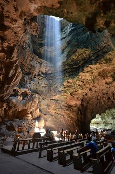 Callao cave chapel The Callao Cave Chapel. The first of the seven chambers converted into a worship place by adding an altar and wooden benches. Light rays filtered through the foliage in the cave ceiling's hole. by Cesar Cambay