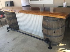 Bryan made this bar for our back patio but it can also be used in our upstairs living room or events that we need to have a bar. Love the Redwood slab, corrugated metal, and wine barrels!