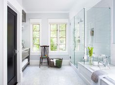 Love the low tub combined with large shower, gray/white tiles and built ins!
