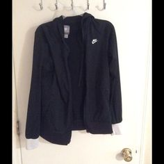 Black nike jacket Black nike jacket with white around the wrists. Gently used good condition has a hood and zips up the front Nike Jackets & Coats