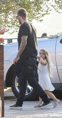 Family celebrations: Harper, four, looked adorable as she joined her devoted father David Beckham for dinner at Nobu restaurant in Malibu to mark her eldest brother Brooklyn's GCSE results