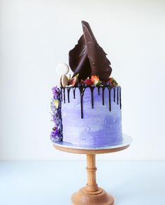 """Cakes by Cliff. """"Never judge a cake by its cover.  Layers of red velvet with Nutella buttercream."""""""
