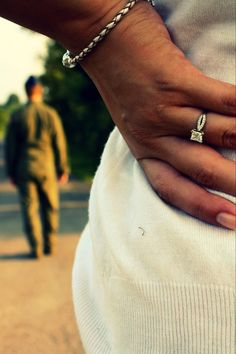 This picture says alot of things to me... Engaged. But the reality is that marrying a military man, means alot of him walking away ...