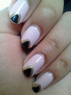 Pink, black,  and gold nail design.