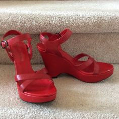 """Red leather wedges Add a splash of red to your spring closet. Super comfortable yet I never found the right outfits to rock these 4"""" wedges. Slight shadow of wear on right heel (from driving). Otherwise, great condition. Michael Shannon Shoes Wedges"""